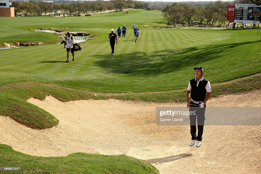 Danny Lee reacts after taking his third shot form the bunker on the 18th during Round One of the Valero Texas Open at the AT&T Oaks Course on March 27, 2014 in San Antonio, Texas.