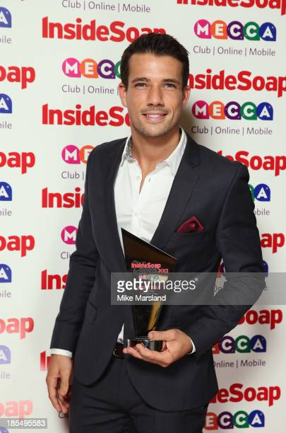 Danny Mac of EastEnders poses with his Sexiest Male Award as he attends The Inside Soap Awards at The Ministry of Sound on October 21 2013 in London...