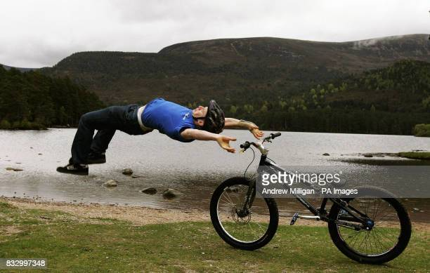 Danny MacAskill shows his bike skills on the shores of Lochan Eilein in preparation for the Outside Festival midsummer weekend in Rothiemurchus near...