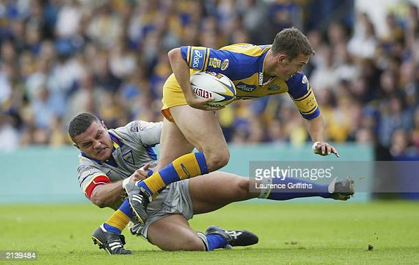 Danny McGuire of Leeds battles with Jon Clarke of Warrington during the Tetley's Super League game between Leeds Rhinos and Warrington Wolves on July...