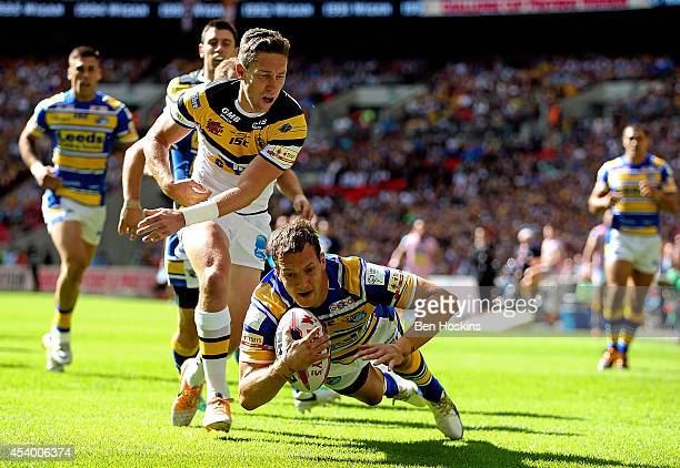 Danny McGuire of Leeds dives over to score a try during the Tetley's Challenge Cup Final between Leeds Rhinos and Castleford Tigers at Wembley...
