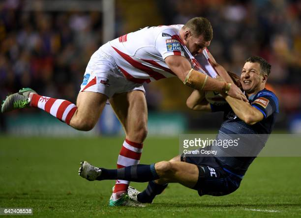 Danny McGuire of Leeds is tackled by Danny Tickle of Leigh during the Betfred Super League match between Leigh Centurions and Leeds Rhinos at Leigh...