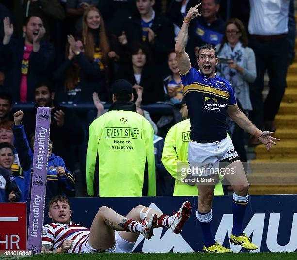 Danny McGuire of Leeds Rhinos celebrates after touching the try line during the Round 2 match of the First Utility Super League Super 8s between...
