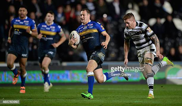 Danny McGuire of Leeds Rhinos gets past Marc Sneyd of Hull FC to score his second try of the match during the First Utility Super League match...