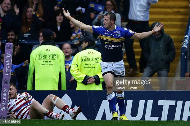 Danny McGuire of Leeds Rhinos is in wonder at the umpires decision to call for a review of his try during the Round 2 match of the First Utility...