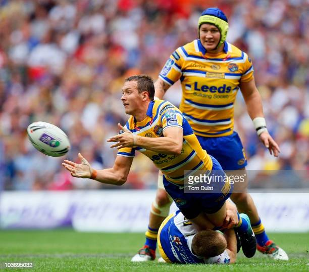 Danny McGuire of Leeds Rhinos passes the ball during the Carnegie Challenge Cup Final match between Leeds Rhinos and Warrington Wolves at the Wembley...