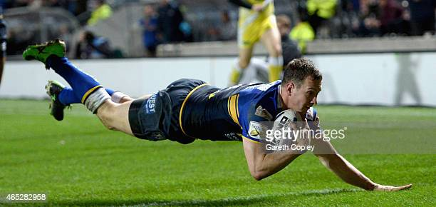 Danny McGuire of Leeds Rhinos scores a second half try during the First Utility Super League match between Hull FC and Leeds Rhinos at KC Stadium on...