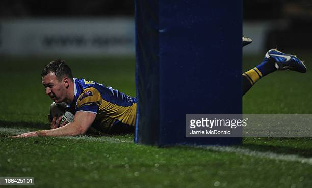 Danny McGuire of Leeds Rhinos scores a try during the Super League match between Leeds Rhinos and London Broncos at Headingley Carnegie Stadium on...