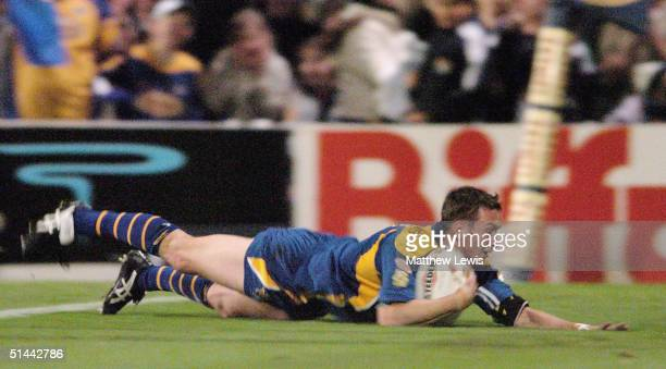 Danny McGuire of Leeds scores a try during the Super League Final Eliminator match between Leeds Rhinos and Wigan Warriors at Headingley on October 8...