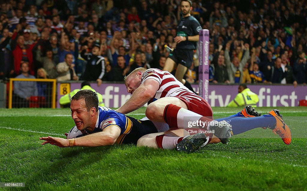 Danny McGuire of the Leeds Rhinos scores his teams third try against of the Wigan Warriors during the First Utility Super League Grand Final between Wigan Warriors and Leeds Rhinos at Old Trafford on October 10, 2015 in Manchester, England.