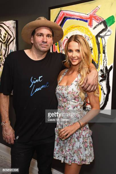 Danny Minnick and Sophie Hermann attend a private view of 'One Love' the first UK solo exhibition from LA artist Danny Minnick at Maddox Gallery in...