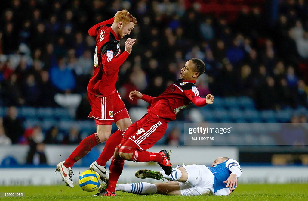 Danny Murphy (R) of Blackburn in action with Bobby Reid and <a gi-track='captionPersonalityLinkClicked' href=/galleries/search?phrase=Ryan+Taylor+-+English+Soccer+Striker+Born+1988&family=editorial&specificpeople=15324100 ng-click='$event.stopPropagation()'>Ryan Taylor</a> (L) of Bristol City during the FA Cup with Budweiser Third Round match between Blackburn Rovers and Bristol City at Ewood Park on January 5, 2013 in Blackburn, England.
