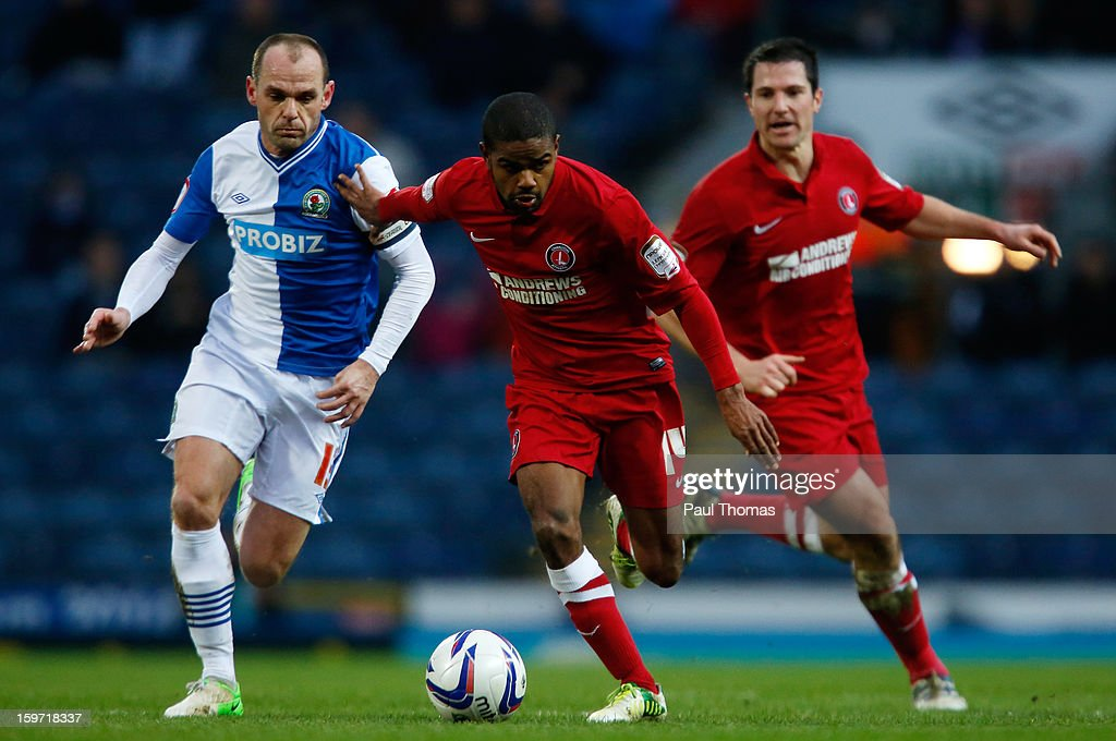 Danny Murphy (L) of Blackburn in action with Bradley Pritchard of Charlton during the npower Championship match between Blackburn Rovers and Charlton Athletic at Ewood Park on January 19, 2013 in Blackburn, England.