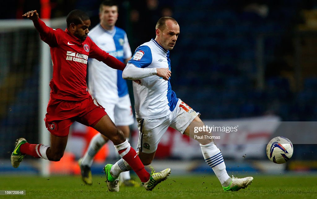 Danny Murphy (R) of Blackburn in action with Bradley Pritchard of Charlton during the npower Championship match between Blackburn Rovers and Charlton Athletic at Ewood Park on January 19, 2013 in Blackburn, England.
