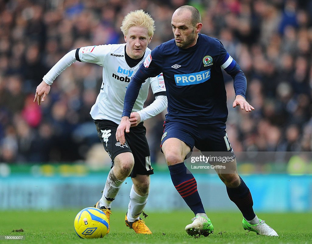 Danny Murphy of Blackburn Rovers battles with Will Hughes of Derby County during the FA Cup with Budweiser Fourth Round match between Derby County and Blackburn Rovers at Pride Park Stadium on January 26, 2013 in Derby, England.