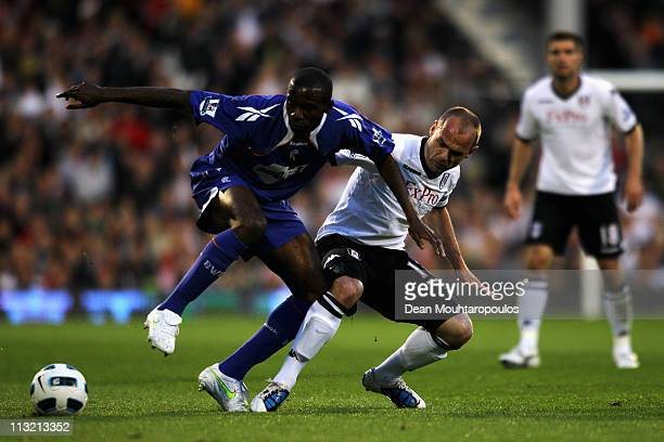 Danny Murphy of Fulham and Fabrice Muamba of Bolton battle for the ball during the Barclays Premier League match between Fulham and Bolton Wanderers...