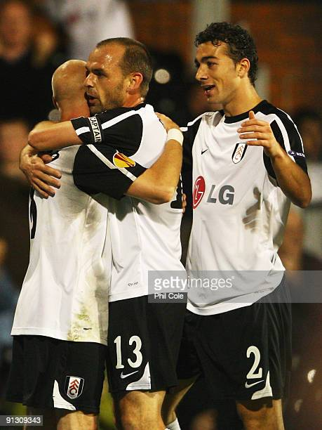 Danny Murphy of Fulham celebrates scoring their first goal with Paul Konchesky and Stephen Kelly during the UEFA Europa League Group H match between...