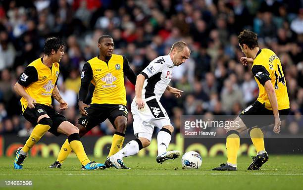 Danny Murphy of Fulham in action during the Barclays Premier League match between Fulham and Blackburn Rovers at Craven Cottage on September 11 2011...