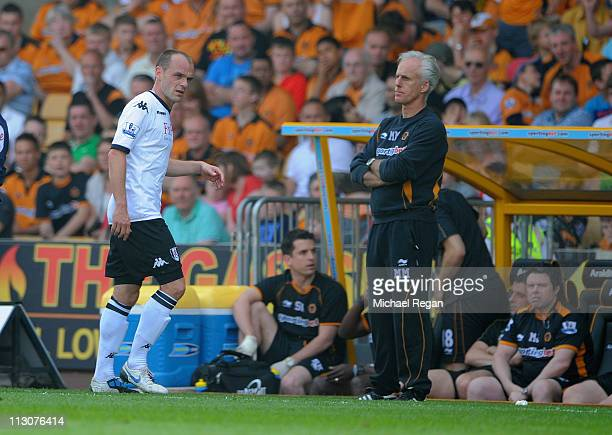 danny Murphy of Fulham is subbed as Wolves manager Mick McCarthy looks on during the Barclays Premier League match between Wolverhampton Wanderers...