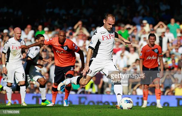 Danny Murphy of Fulham scores their second goal from the penalty spot during the Barclays Premier League match between Fulham and Queens Park Rangers...