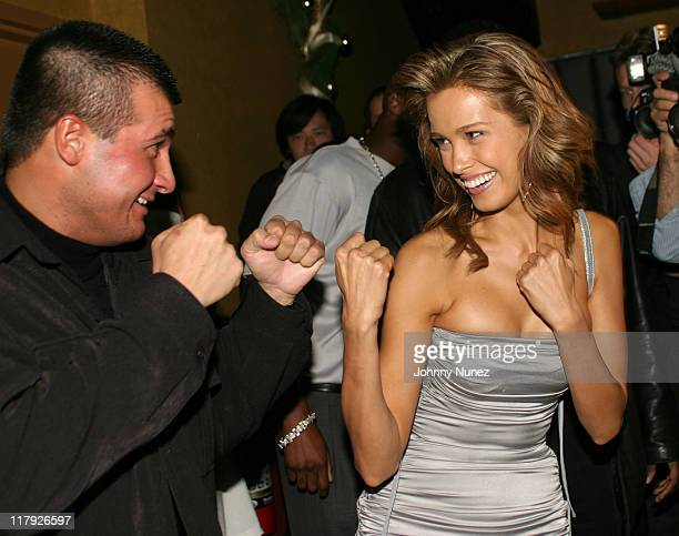 Danny Musico and Petra Nemcova during Petra Nemcova Unveils the 2004 Sports Illustrated Swimsuit Calendar at Spider Club in New York City New York...
