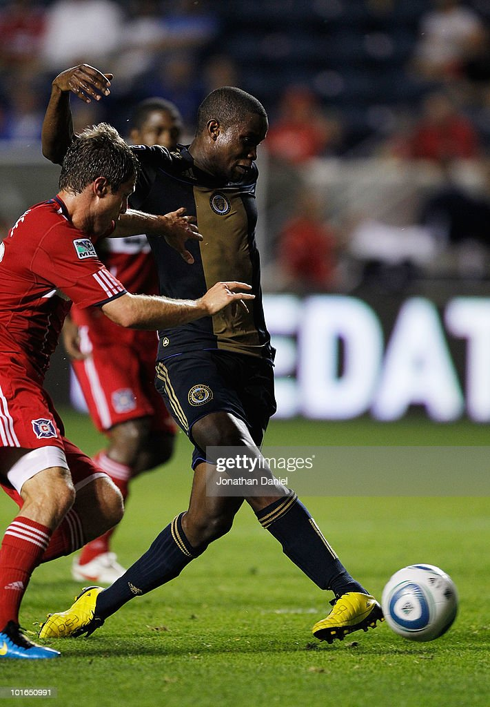 Danny Mwango #10 of the Philadelphia Union scores a goal in the closing minutes under pressure from Logan Pause #12 of the Chicago Fire in an MLS match on June 5, 2010 at Toyota Park in Brideview, Illinois. The Fire defeated the Union 2-1.