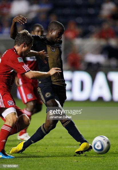 Danny Mwango of the Philadelphia Union scores a goal in the closing minutes under pressure from Logan Pause of the Chicago Fire in an MLS match on...