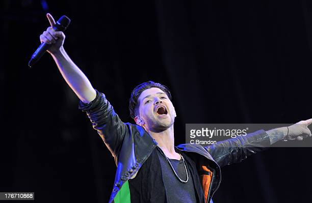 Danny O'Donaghue of The Script performs on stage during Day 1 of the V Festival 2013 at Hylands Park on August 17 2013 in Chelmsford England