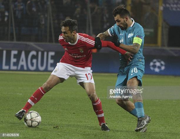 Danny of FC Zenit in action against Jonas Goncalves of Benfica during the UEFA Champions League round 16 secondleg football match between FC Zenit...
