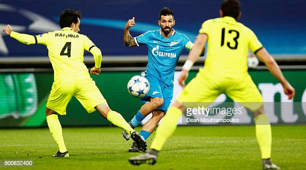 Danny of Zenit Saint Petersburg shoots on goal in front of Rafinha and Stefan Mitrovic of Gent during the group H UEFA Champions League match between...