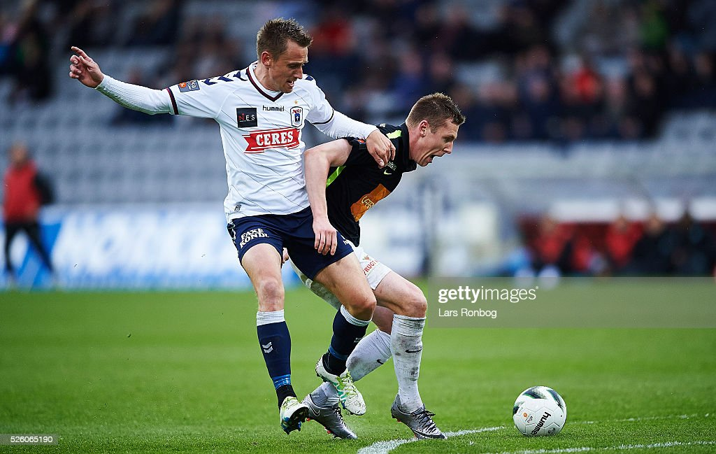 Danny Olsen of AGF Aarhus and Lukas Lerager of Viborg FF compete for the ball during the Danish Alka Superliga match between AGF Aarhus and Viborg FF at Ceres Park on April 29, 2016 in Aarhus, Denmark.