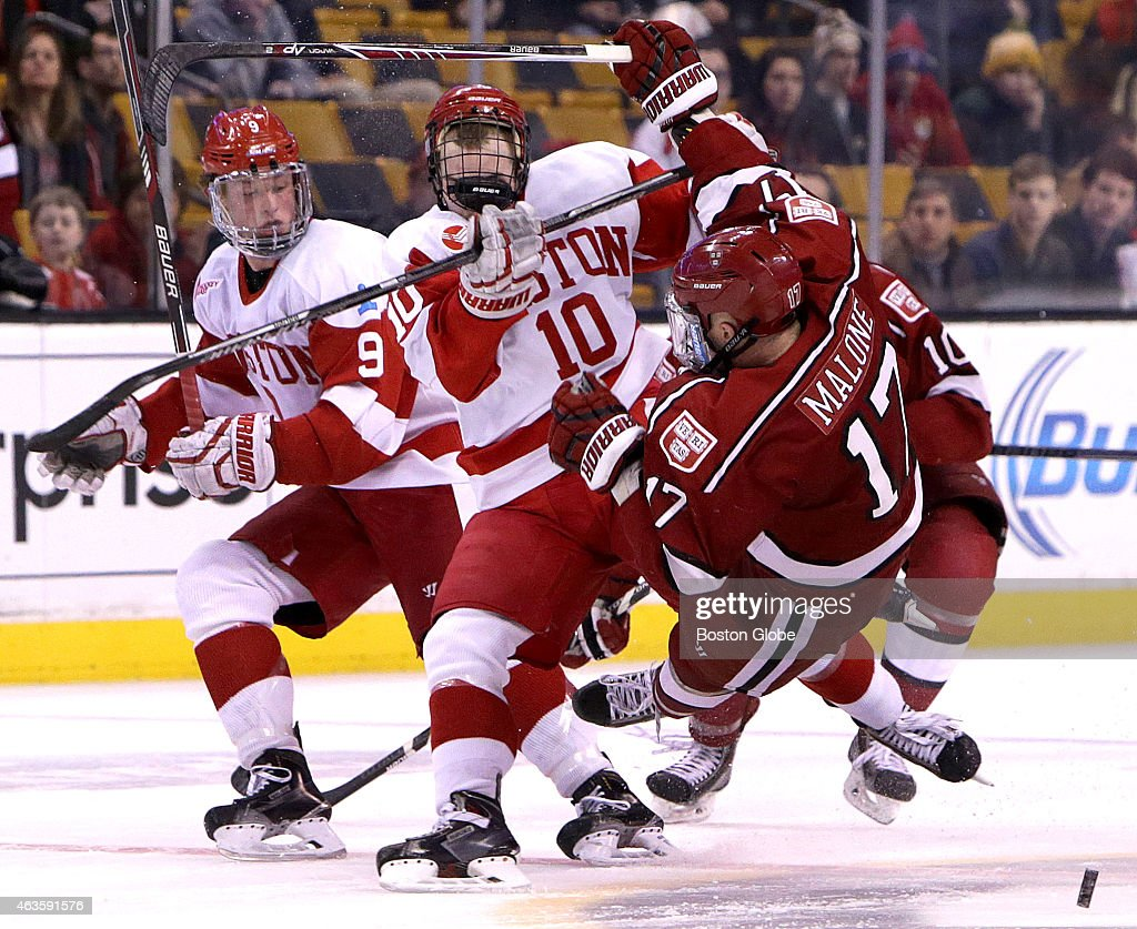 Danny O'Regan delivers a heavy open ice hit to Harvard University forward Sean Malone Boston University takes on Harvard in the first round of the...
