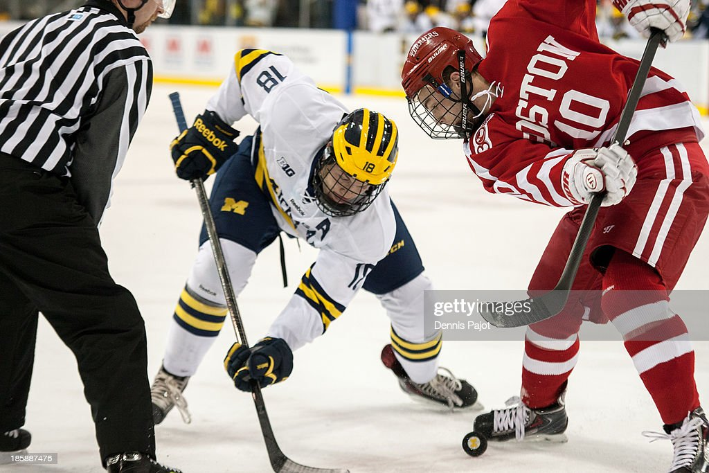 Danny O'Regan #10 of the Boston University Terriers faces off against Andrew Copp #18 of the Michigan Wolverines on October 25, 2013 at Yost Ice Arena in Ann Arbor, Michigan.
