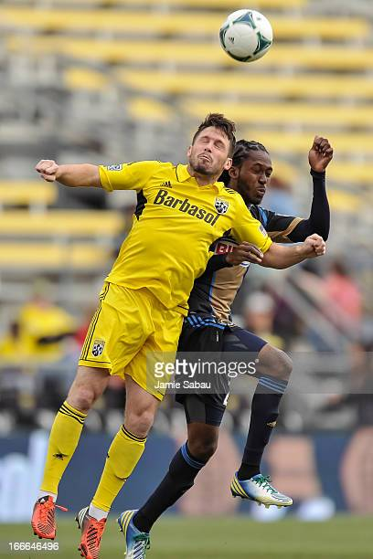 Danny O'Rourke of the Columbus Crew and Keon Daniel of the Philadelphia Union battle for control of the ball on April 6 2013 at Crew Stadium in...