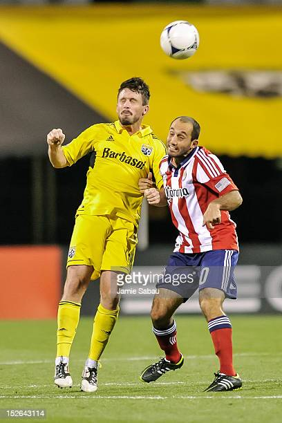 Danny O'Rourke of the Columbus Crew and Nick LaBrocca of Chivas USA battle for control of the ball on September 19 2012 at Crew Stadium in Columbus...