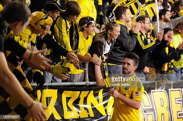 Danny O'Rourke of the Columbus Crew greets the fans after the Crew defeated Chivas USA 10 on September 19 2012 at Crew Stadium in Columbus Ohio