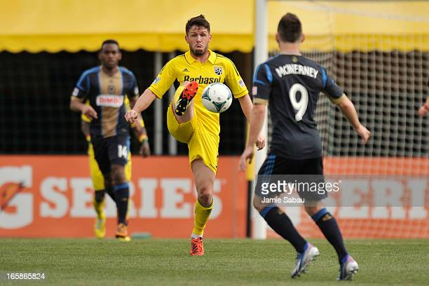 Danny O'Rourke of the Columbus Crew takes control of the ball in the first half as Jack McInerney of Philadelphia Union watches on April 6 2013 at...