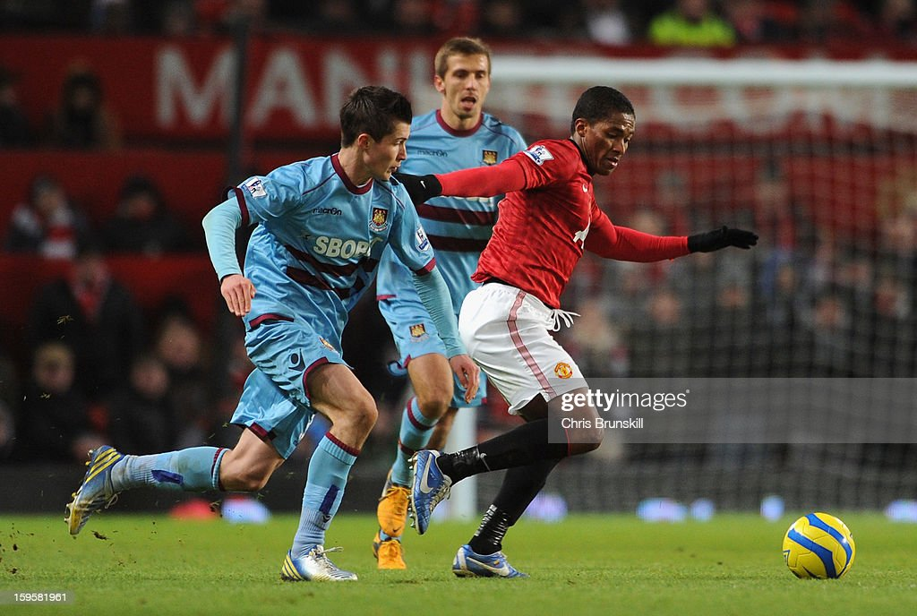 Danny Potts of West Ham United competes with Luis <a gi-track='captionPersonalityLinkClicked' href=/galleries/search?phrase=Antonio+Valencia&family=editorial&specificpeople=543830 ng-click='$event.stopPropagation()'>Antonio Valencia</a> of Manchester United during the FA Cup with Budweiser Third Round Replay match between Manchester United and West Ham United at Old Trafford on January 16, 2013 in Manchester, England.