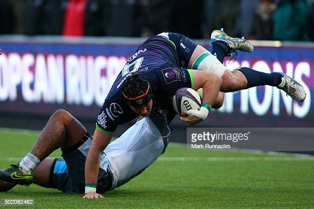 Danny Qualter of Connacht Rugby is tackled Sonatane Takulua of Newcastle Falcons in the first half during the European Rugby Challenge Cup pool 1...