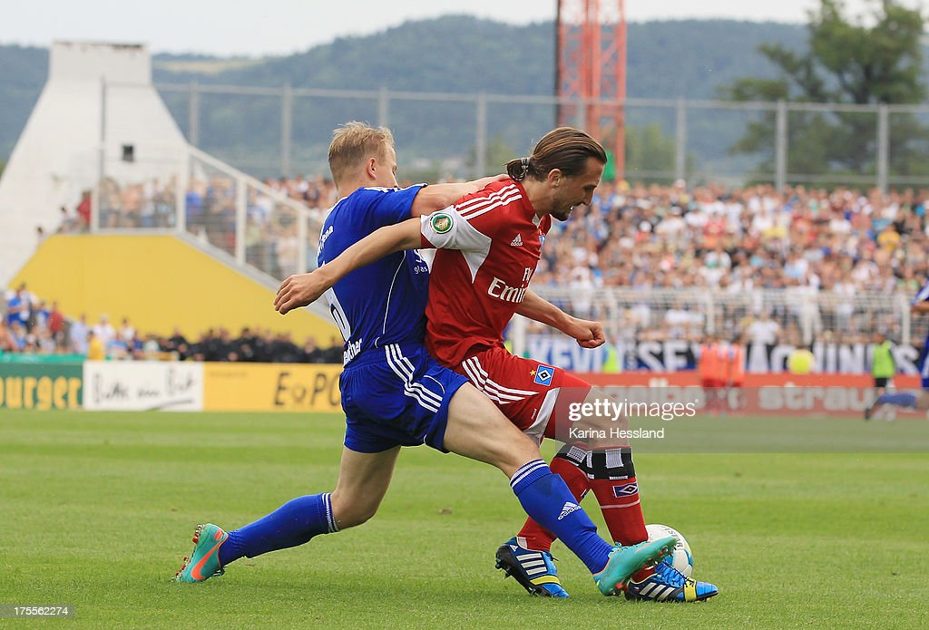 Danny Reuther of Jena and Petr Jiracek of Hamburg battle for the ball during the DFB Cup between SV Schott Jena and Hamburger SV at Ernst-Abbe-Sportfeld on August 04, 2013 in Jena,Germany.