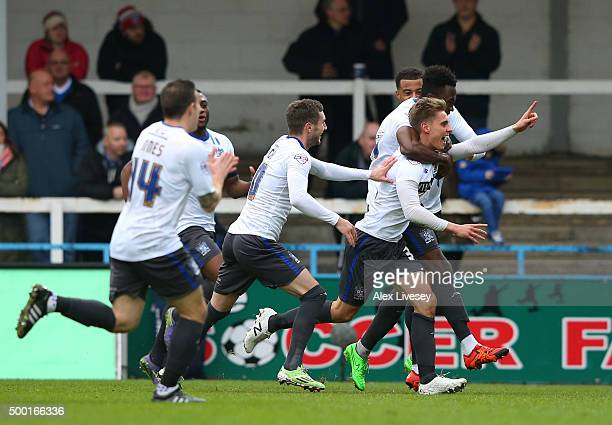 Danny Rose of Bury celebrates with team mates after scoring the opening goal during The Emirates FA Cup Second Round match between Rochdale and Bury...