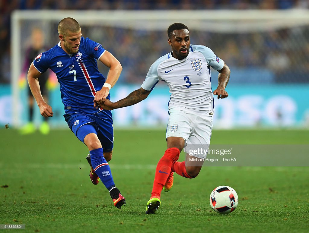Danny Rose of England and Johann Gudmundsson of Iceland compete for the ball during the UEFA EURO 2016 round of 16 match between England and Iceland at Allianz Riviera Stadium on June 27, 2016 in Nice, France.
