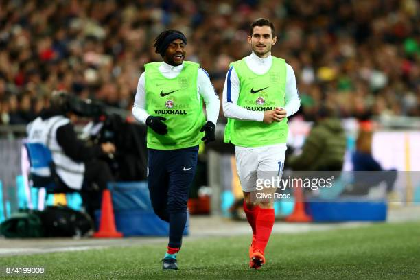 Danny Rose of England and Lewis Cook of England warm up during the international friendly match between England and Brazil at Wembley Stadium on...
