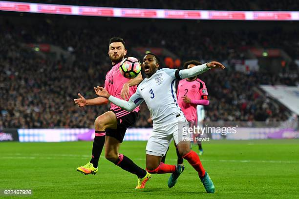 Danny Rose of England is challenged by Robert Snodgrass of Scotland during the FIFA 2018 World Cup qualifying match between England and Scotland at...