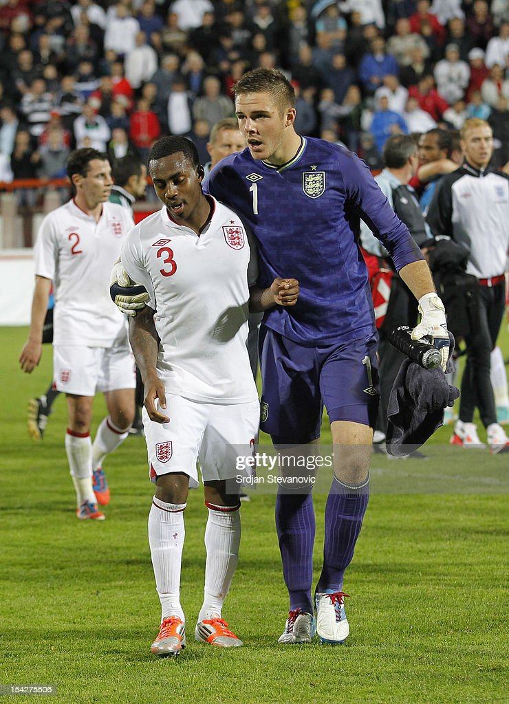 Danny Rose (L) of England is led away by team-mate Jack Butland of England after the Under 21 European Championship Play Off second leg match between Serbia U21 and England U21 at Stadium Mladost on October 16, 2012 in Krusevac, Serbia.