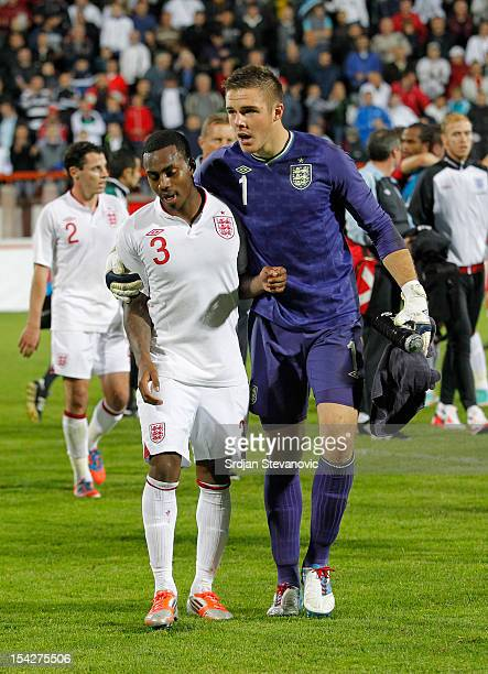 Danny Rose of England is led away by teammate Jack Butland of England after the Under 21 European Championship Play Off second leg match between...