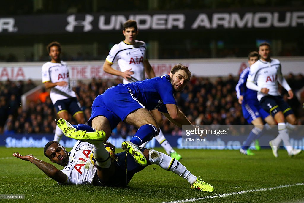 Danny Rose of Spurs challenges Branislav Ivanovic of Chelsea during the Barclays Premier League match between Tottenham Hotspur and Chelsea at White...