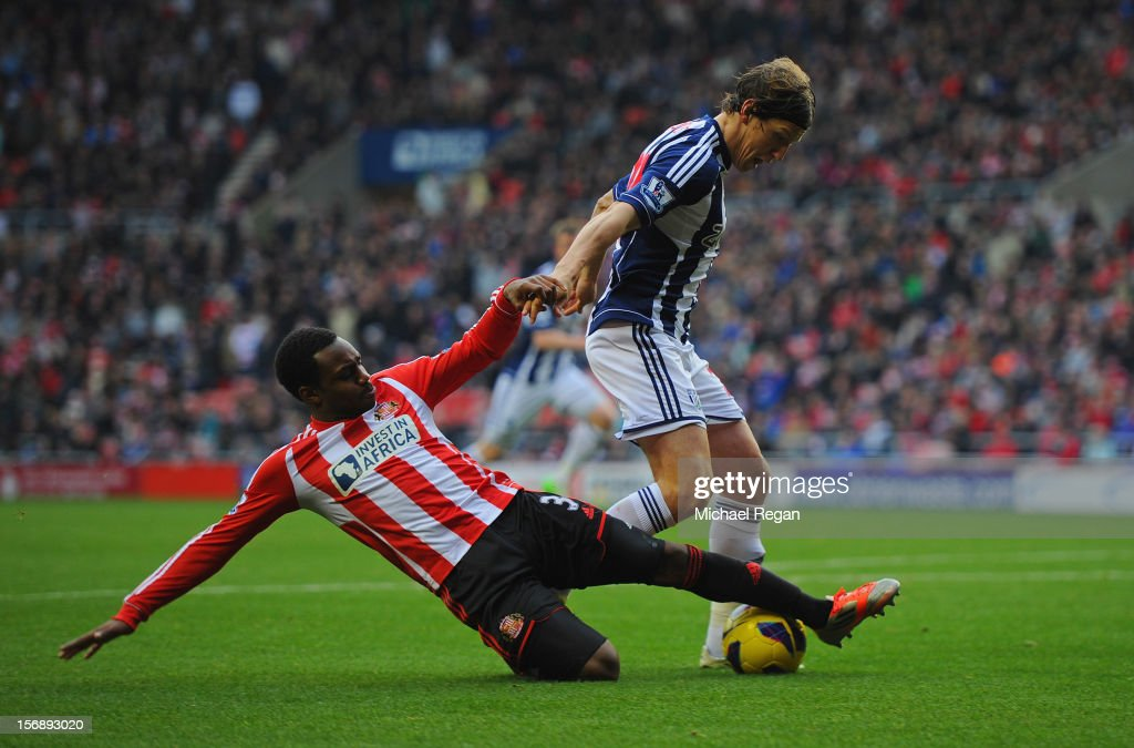 Danny Rose of Sunderland tackles Billy Jones of West Brom during the Barclays Premier League match between Sunderland and West Bromwich Albion at the Stadium of Light on November 24, 2012 in Sunderland, England.