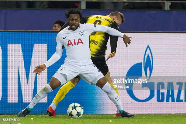 Danny Rose of Tottenham Hotspur and Andrey Yarmolenko of Borussia Dortmund battle for the ball during the UEFA Champions League group H match between...