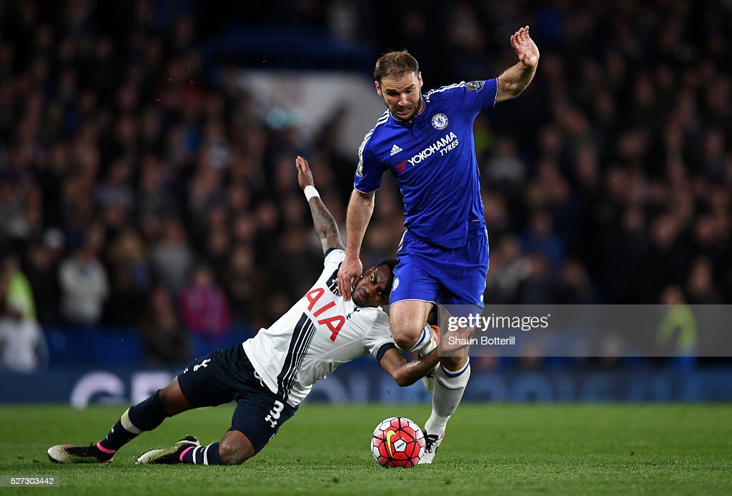 Danny Rose of Tottenham Hotspur and Branislav Ivanovic of Chelsea battle for the ball during the Barclays Premier League match between Chelsea and...